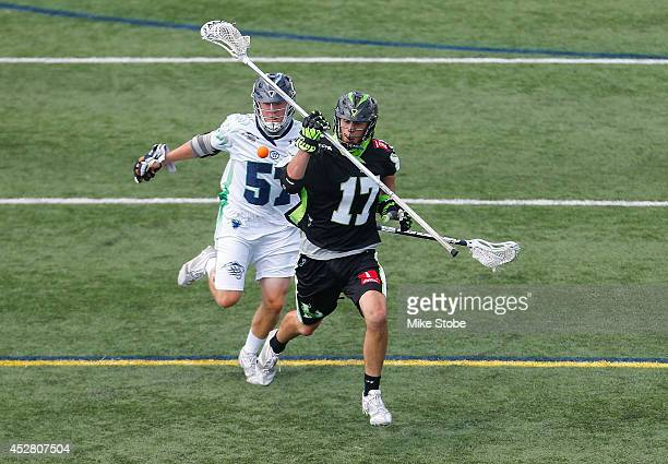 Joe Flecther of the New York Lizards has the ball knocked out by Peet Poillon of the Chesapeake Bayhawks at Stony Brook Universary on July 27 2014 in...
