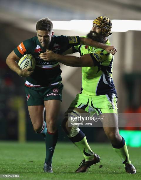 Joe Ford of Leicester Tigers holds off Josh Strauss of Sale Sharks during the Aviva Premiership match between Leicester Tigers and Sale Sharks at...