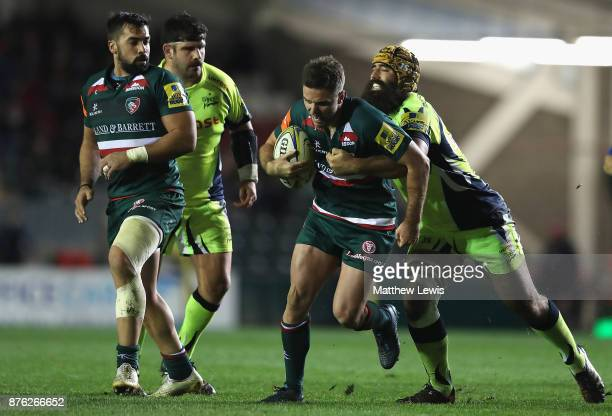 Joe Ford of Leicester Tigers is tackled by Josh Strauss of Sale Sharks during the Aviva Premiership match between Leicester Tigers and Sale Sharks at...