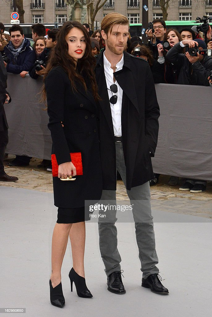 Joe Foster and Chelsea Tyler attend the Christian Dior - Outside Arrivals - PFW F/W 2013 at Hotel des Invalides on March 1rst, 2013 in Paris, France.