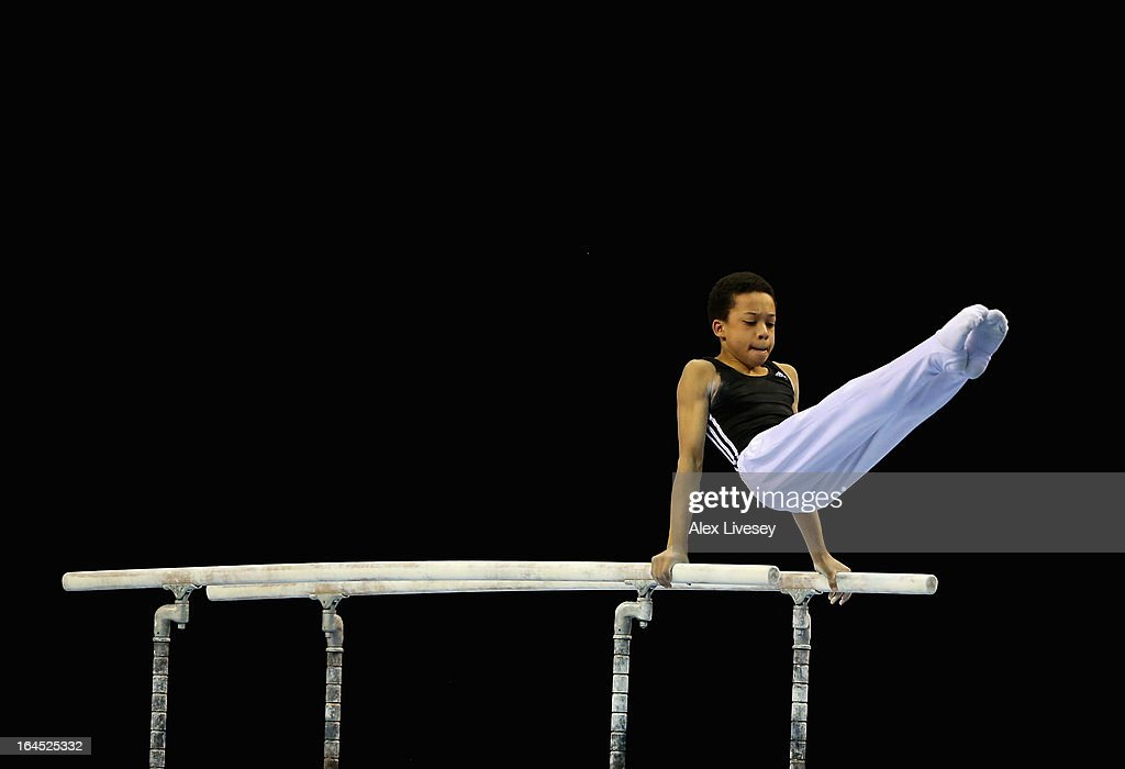 Joe Fraser of City of Bormingham competes in the Parallel Bars in the Men's Masters event at the Men's and Women's British Gymnastics Championships at the Echo Arena on March 24, 2013 in Liverpool, England.