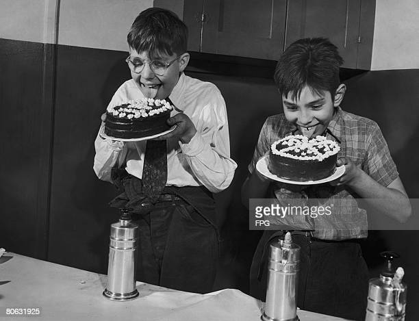 Joe Freund 12 and a half and William Moran aged 11 winner and runner up in the boy's cake decorating competition at the Gramercy Boy's Club in New...