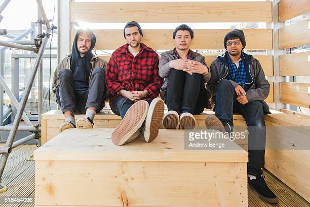 Joe Galarraga Brendan Finn Carlos Salguero Jr and Amar Lal of Big Ups pose at Headrow House on March 31 2016 in Leeds England