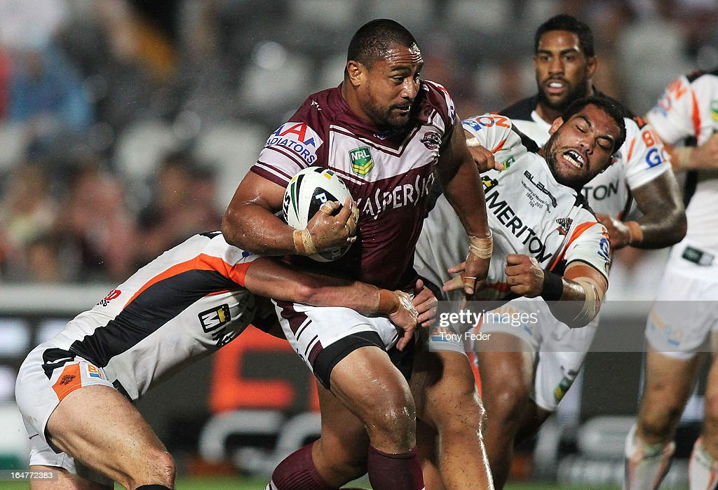 Joe Galuvao of the Sea Eagles breaks through Wests defence during the round four NRL match between the Manly Sea Eagles and the Wests Tigers at Bluetongue Stadium on March 28, 2013 in Gosford, Australia.