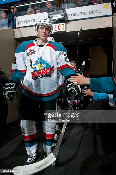 Joe Gatenby of the Kelowna Rockets high fives fans on his way to the ice against the Seattle Thunderbirds on April 3 2014 during Game 1 of the second...