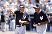 Joe Girardi of the New York Yankees and former New York Jets quarterback Joe Namath walk out to home plate to deliver the lineup before the start of...
