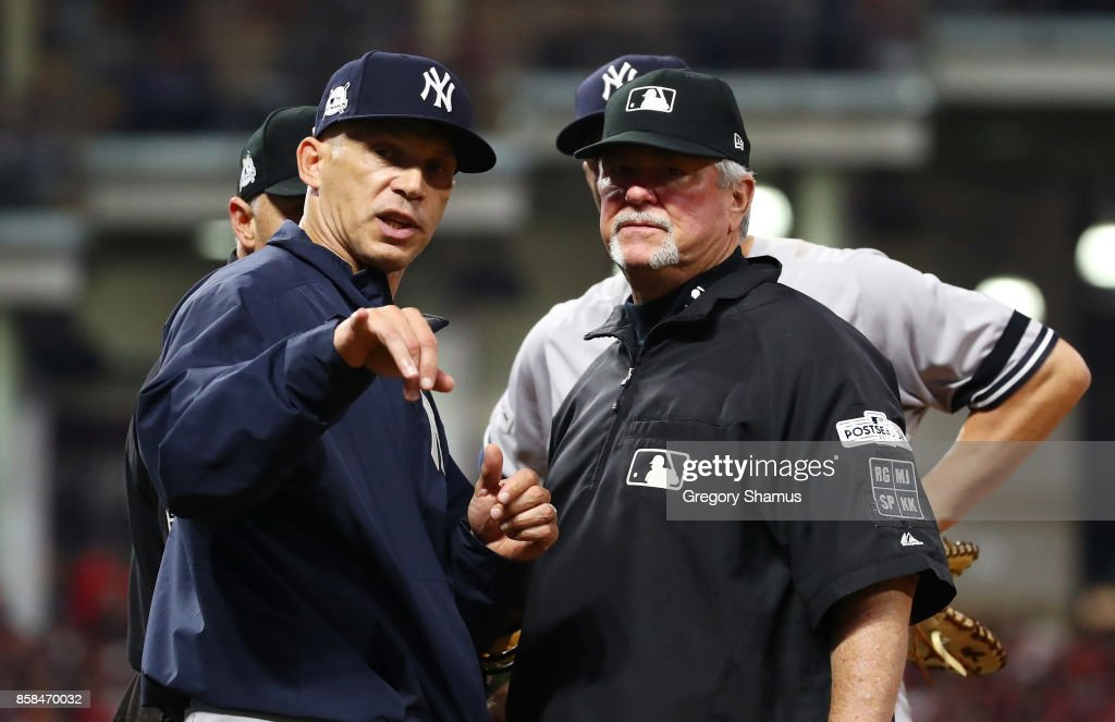 Joe Girardi #28 of the New York Yankees argues a call in the tenth inning against the Cleveland Indians during game two of the American League Division Series at Progressive Field on October 6, 2017 in Cleveland, Ohio.