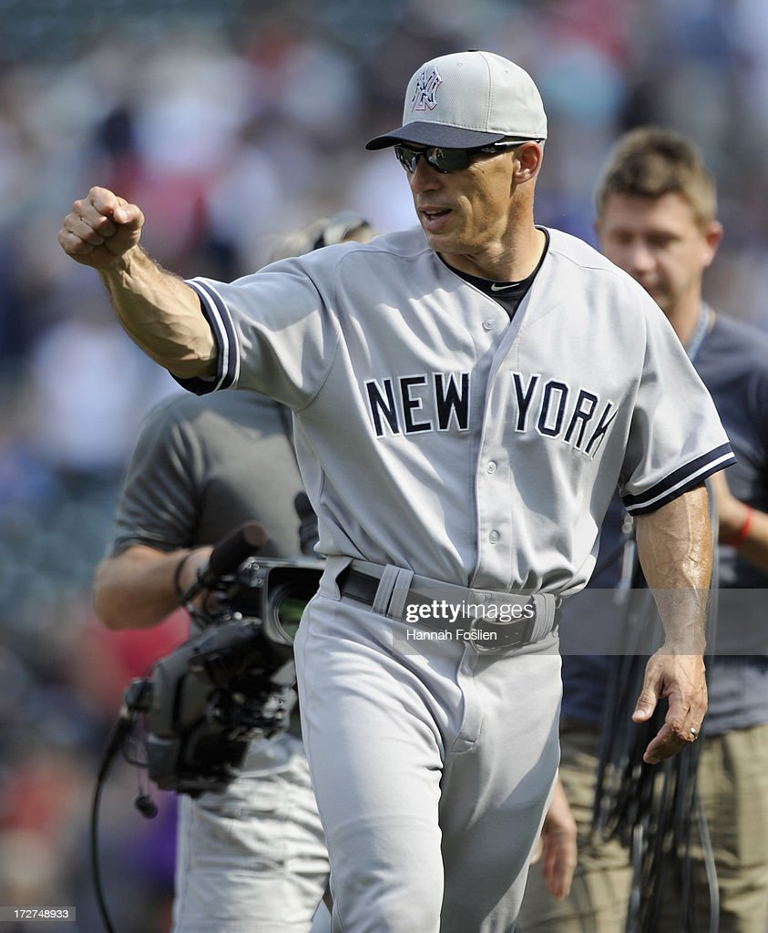 <a gi-track='captionPersonalityLinkClicked' href=/galleries/search?phrase=Joe+Girardi&family=editorial&specificpeople=208659 ng-click='$event.stopPropagation()'>Joe Girardi</a> #28 of the New York Yankees celebrates a win of the game against the Minnesota Twins on July 4, 2013 at Target Field in Minneapolis, Minnesota. The Yankees defeated the Twins 9-5.
