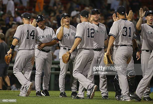 Joe Girardi of the New York Yankees celebrates with his team after defeating the Boston Red Sox 138 at Fenway Park on September 2 2015 in Boston...