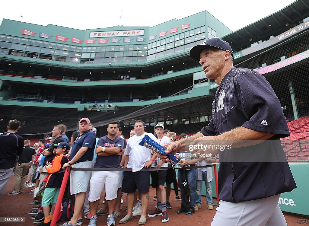 Joe Girardi of the New York Yankees heads to the batting cage before a game against Boston Red Sox at Fenway Park on August 10 2016 in Boston...