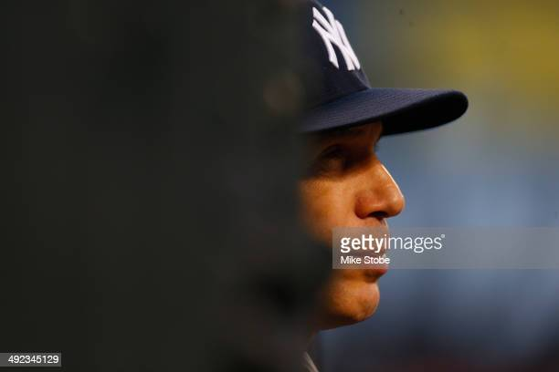 Joe Girardi of the New York Yankees looks on from the dugout in the second inning against the New York Mets on May 15 2014 at Citi Field in the...