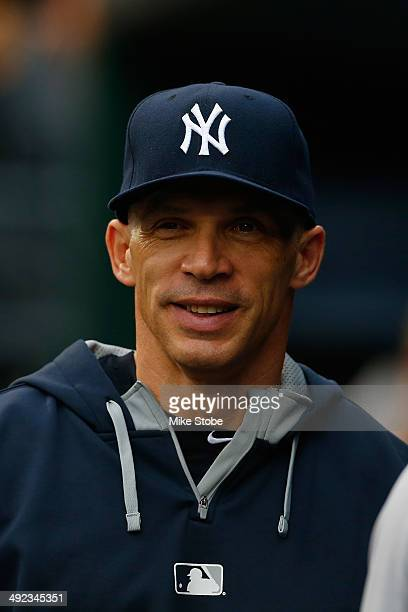 Joe Girardi of the New York Yankees looks on from the dugout prior to the game against the New York Mets on May 15 2014 at Citi Field in the Flushing...