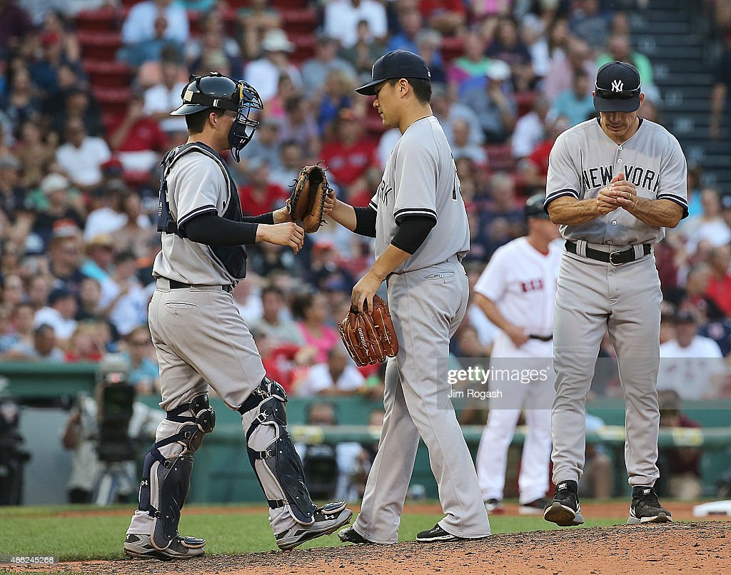 Joe Girardi #28 of the New York Yankees relieves as John Ryan Murphy #66 and Masahiro Tanaka #19 react in the seventh inning against the Boston Red Sox at Fenway Park on September 2, 2015 in Boston, Massachusetts.