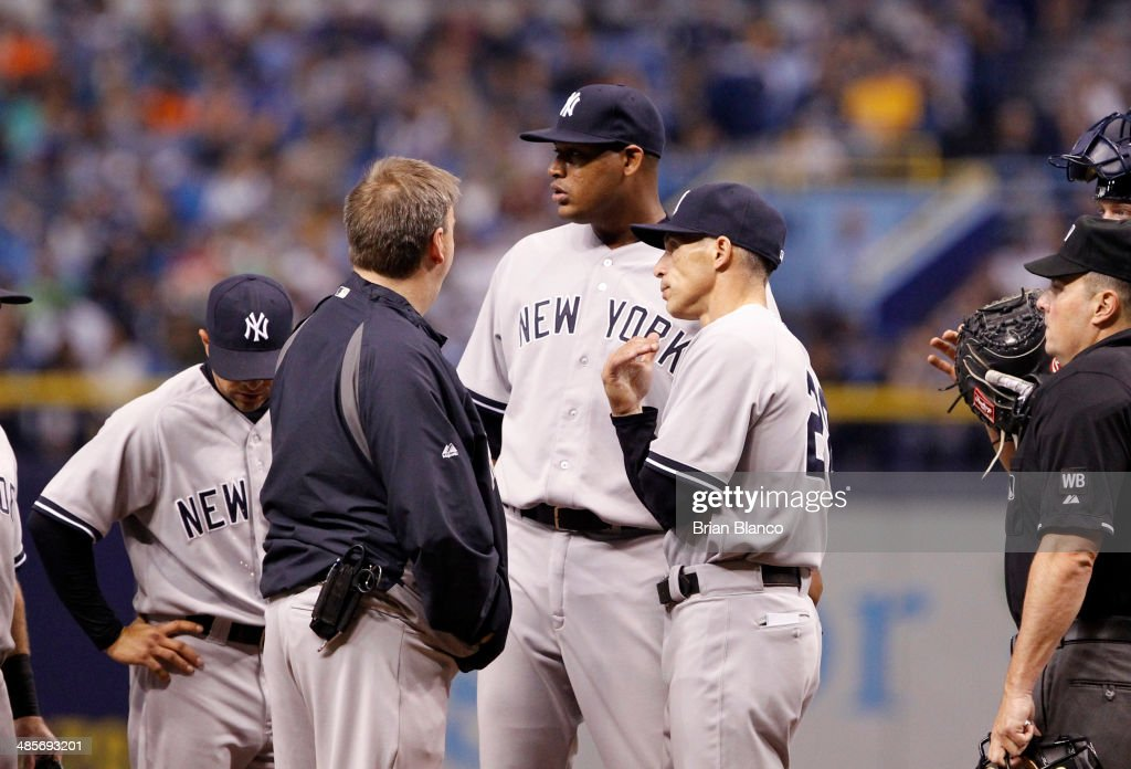 <a gi-track='captionPersonalityLinkClicked' href=/galleries/search?phrase=Joe+Girardi&family=editorial&specificpeople=208659 ng-click='$event.stopPropagation()'>Joe Girardi</a> #28 of the New York Yankees takes pitcher <a gi-track='captionPersonalityLinkClicked' href=/galleries/search?phrase=Ivan+Nova&family=editorial&specificpeople=5743486 ng-click='$event.stopPropagation()'>Ivan Nova</a> #47 of the New York Yankees off the mound during the fifth inning of a game against the Tampa Bay Rays on April 19, 2014 at Tropicana Field in St. Petersburg, Florida.