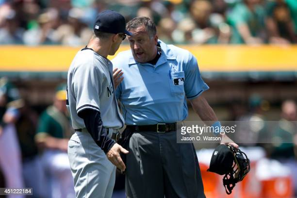 Joe Girardi of the New York Yankees talks to umpire Dale Scott after a called third strike on Brian McCann during the fourth inning against the...