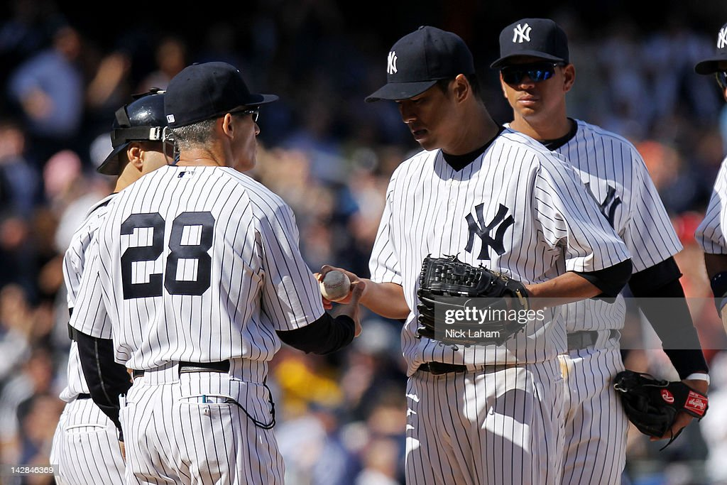 <a gi-track='captionPersonalityLinkClicked' href=/galleries/search?phrase=Joe+Girardi&family=editorial&specificpeople=208659 ng-click='$event.stopPropagation()'>Joe Girardi</a> #28 pulls starting pitcher <a gi-track='captionPersonalityLinkClicked' href=/galleries/search?phrase=Hiroki+Kuroda&family=editorial&specificpeople=5498664 ng-click='$event.stopPropagation()'>Hiroki Kuroda</a> #18 out of the game in the ninth inning against the Los Angeles Angels during the home opener at Yankee Stadium on April 13, 2012 in the Bronx borough of New York City.