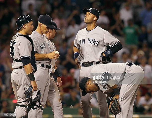 Joe Girardi Russell Martin Jayson Nix Derek Jeter Robinson Cano of the New York Yankees of the New York Yankees await pitching change against the...