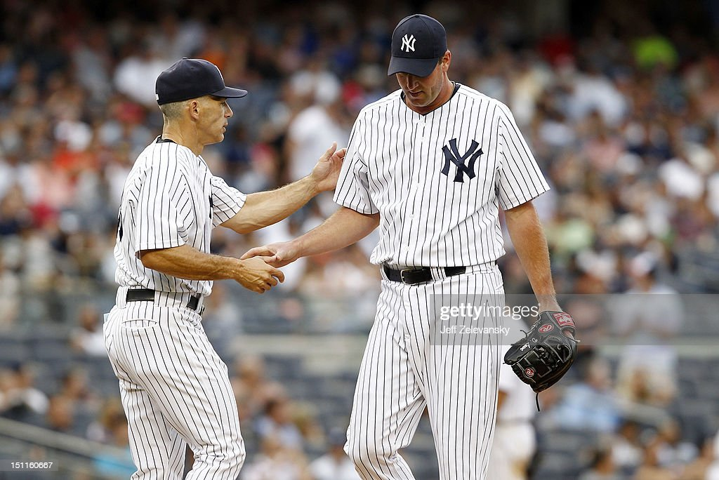 <a gi-track='captionPersonalityLinkClicked' href=/galleries/search?phrase=Joe+Girardi&family=editorial&specificpeople=208659 ng-click='$event.stopPropagation()'>Joe Girardi</a> #28 takes the ball from <a gi-track='captionPersonalityLinkClicked' href=/galleries/search?phrase=Derek+Lowe&family=editorial&specificpeople=171333 ng-click='$event.stopPropagation()'>Derek Lowe</a> #34 of the New York Yankees against the Baltimore Orioles at Yankee Stadium on September 2, 2012 in the Bronx borough of New York City.