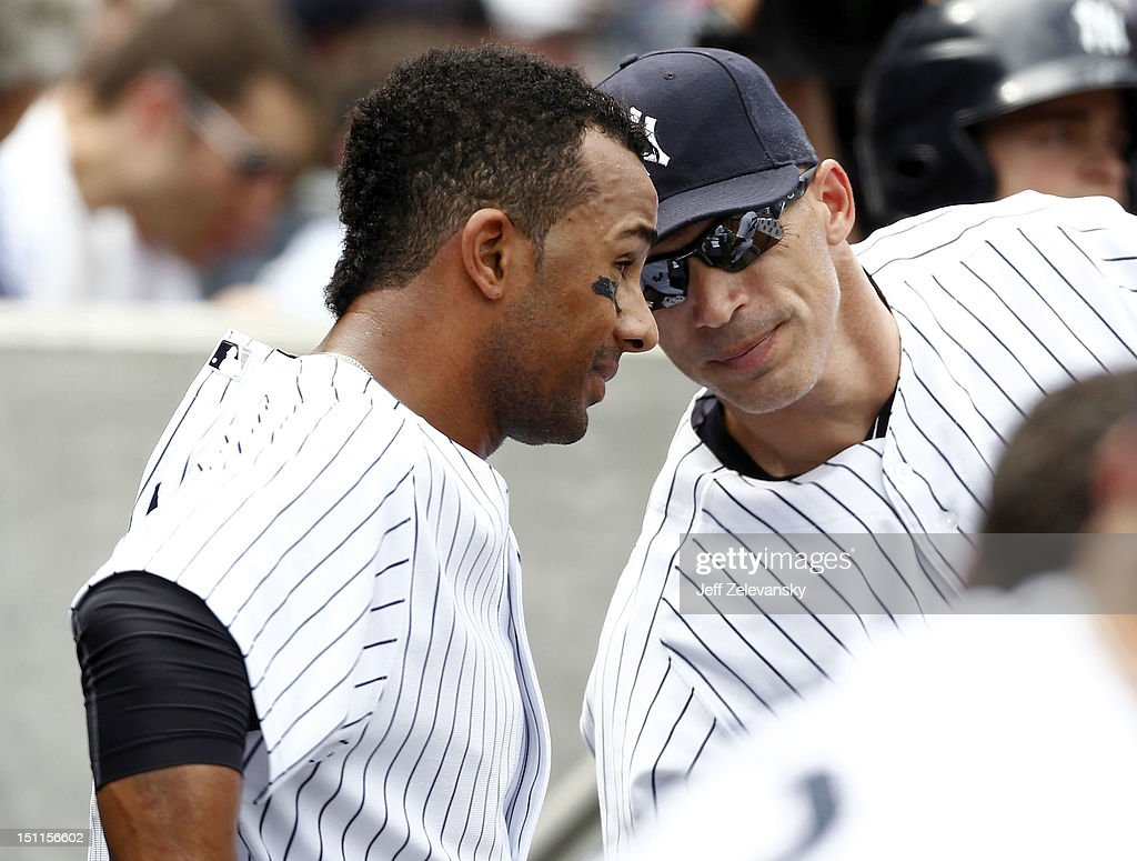 <a gi-track='captionPersonalityLinkClicked' href=/galleries/search?phrase=Joe+Girardi&family=editorial&specificpeople=208659 ng-click='$event.stopPropagation()'>Joe Girardi</a> #28 talks with Chris Dickerson #60 of the New York Yankees against the Baltimore Orioles at Yankee Stadium on September 2, 2012 in the Bronx borough of New York City.