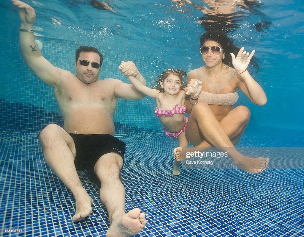 Joe Giudice, Teresa Giudice and daughter Audriana Giudice pose underwater at Majestic Resort on March 4, 2013 in Punta Cana, Dominican Republic.