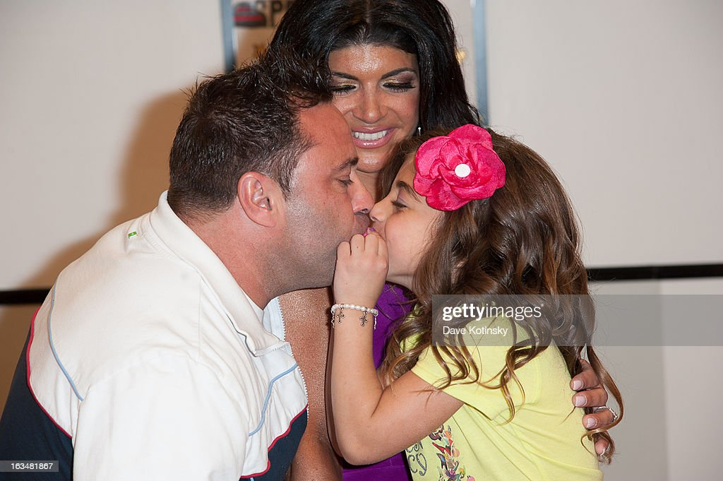 Joe Giudice, Teresa Giudice and Milania Giudice attend Milania Giudice's 7th Birthday Celebration at Just Kidding on March 10, 2013 in Wayne, New Jersey.