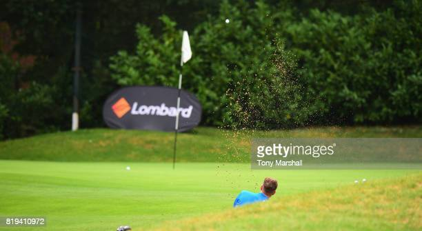 Joe Goddard of Crews Hill Golf Club chips out of a bunker on to the 18th green during the PGA Lombard Trophy East Qualifier at Sandy Lodge Golf Club...