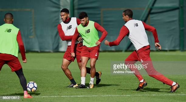 Joe Gomez and Alex OxladeChamberlain of Liverpool during a training session at Melwood Training Ground on October 12 2017 in Liverpool England