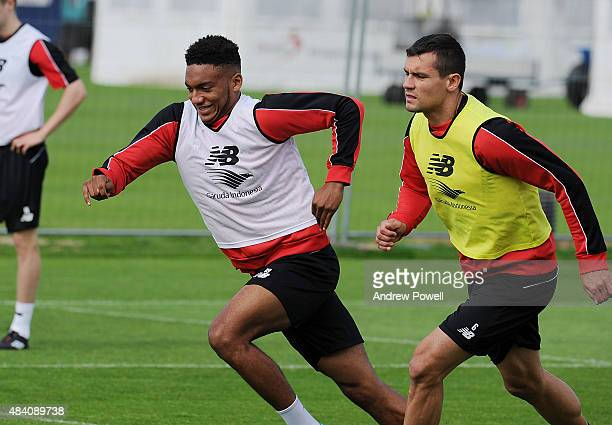 Joe Gomez and Dejan Lovren of Liverpool in action during a training session at Melwood Training Ground on August 15 2015 in Liverpool England