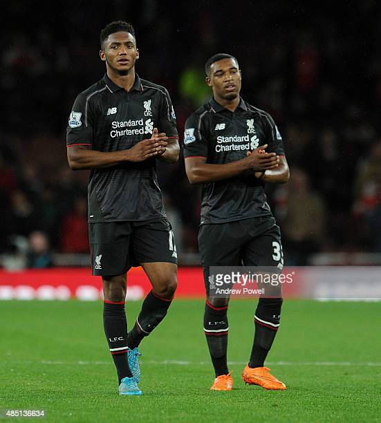 Joe Gomez and Jordon Ibe of Liverpool shows his appreciation to the fans at the end of the Barclays Premier League match between Arsenal and...