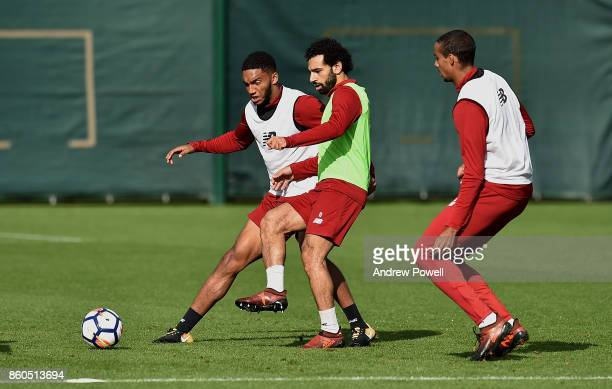 Joe Gomez and Mohamed Salah of Liverpool during a training session at Melwood Training Ground on October 12 2017 in Liverpool England