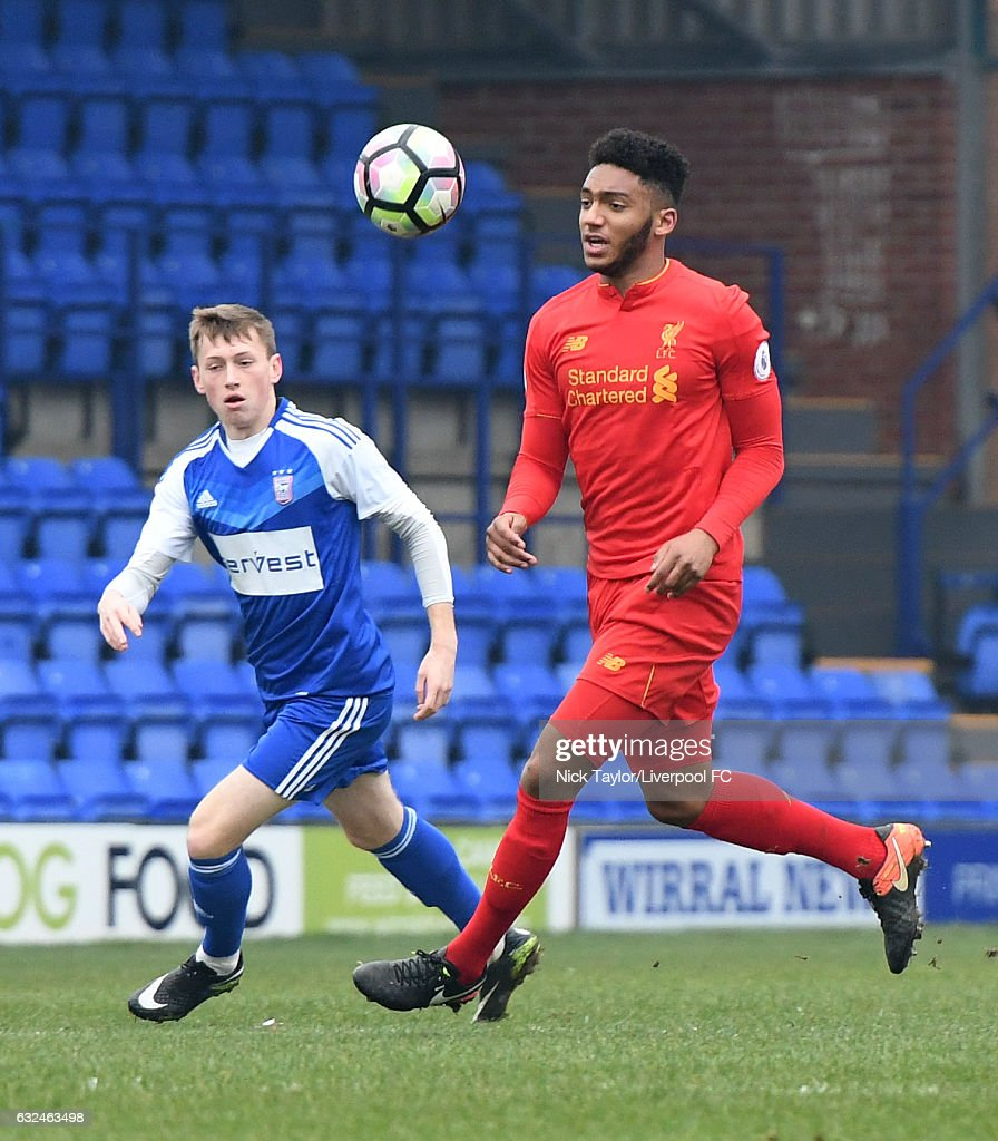 Joe Gomez of Liverpool and Ben Morris of Ipswich Town in action during the Liverpool v Ipswich Town Premier league Cup game at Prenton Park on January 22, 2017 in Birkenhead, England.