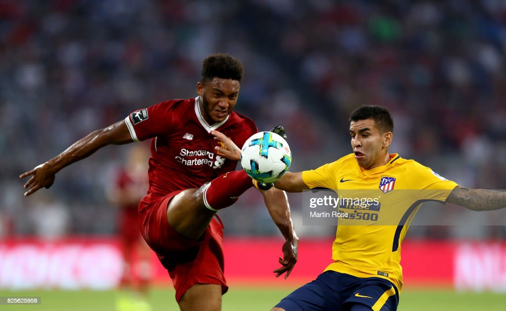 Joe Gomez (L) of Liverpool and Correa of Atletico Madrid battle for the ball during the Audi Cup 2017 match between Liverpool FC and Atletico Madrid at Allianz Arena on August 2, 2017 in Munich, Germany.