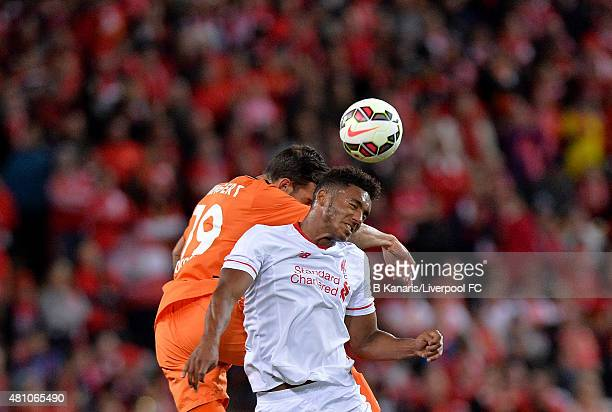 Joe Gomez of Liverpool and Jack Hingert of the Roar compete for the ball during the international friendly match between Brisbane Roar and Liverpool...