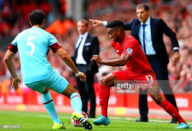 Joe Gomez of Liverpool and James Tomkins of West Ham United compete for the ball during the Barclays Premier League match between Liverpool and West...