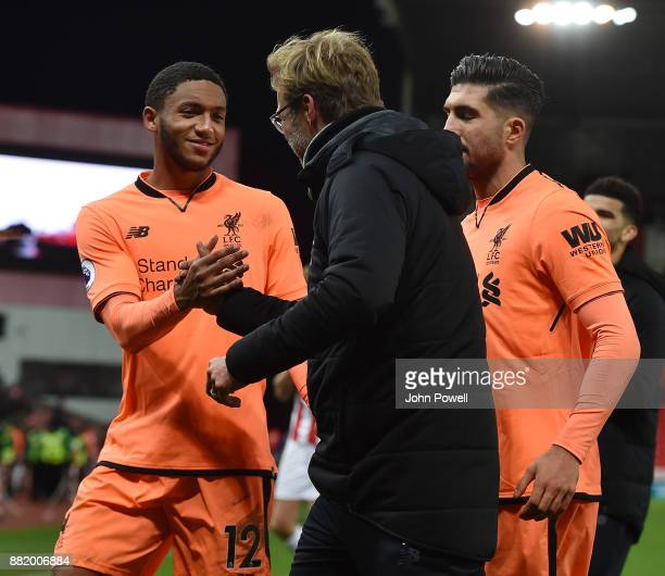 Joe Gomez of Liverpool and Jurgen Klopp manager of Liverpool at the end of the Premier League match between Stoke City and Liverpool at Bet365...