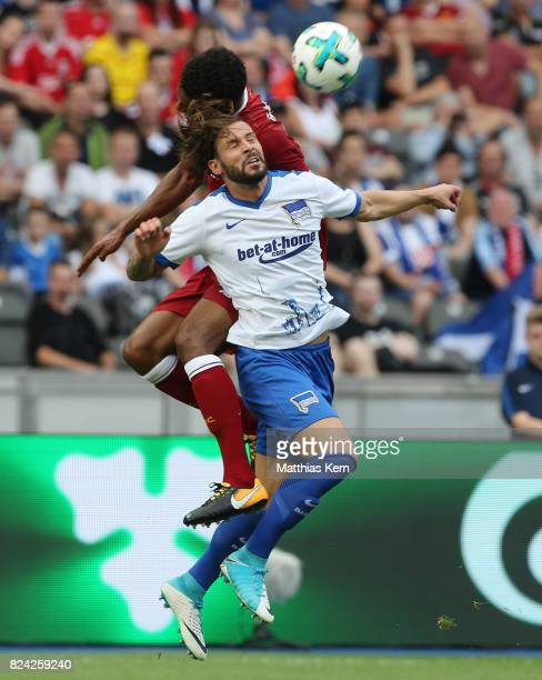 Joe Gomez of Liverpool and Marvin Plattenhardt of Berlin jump for a header during the pre season friendly match between Hertha BSC and FC Liverpool...