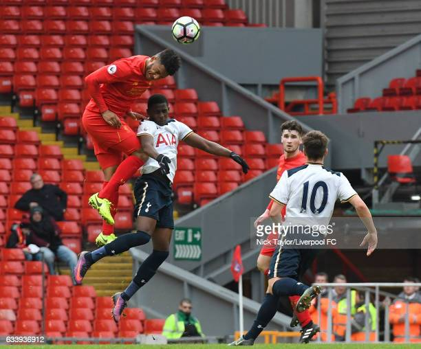 Joe Gomez of Liverpool and Shilow Tracey of Tottenham Hotspur compete for the ball watched by Corey Whelan and Will Miller during Premier League 2...