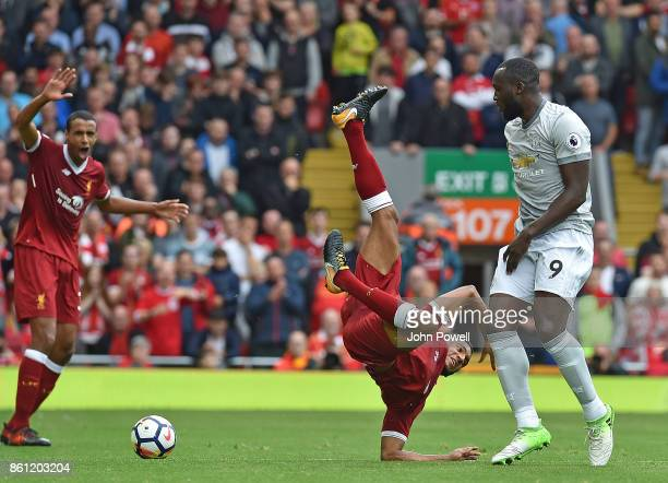 Joe Gomez of Liverpool brought down by Romelu Lukaku during the Premier League match between Liverpool and Manchester United at Anfield on October 14...