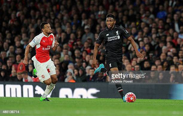 Joe Gomez of Liverpool competes with Francis Coquelin of Arsenal during the Barclays Premier League match between Arsenal and Liverpool on August 24...