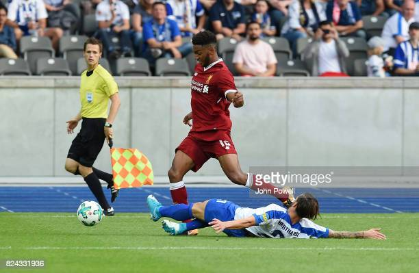 Joe Gomez of Liverpool competes with Karim Rekik of Hertha BSC during the preseason friendly match between Hertha BSC and FC Liverpool at...
