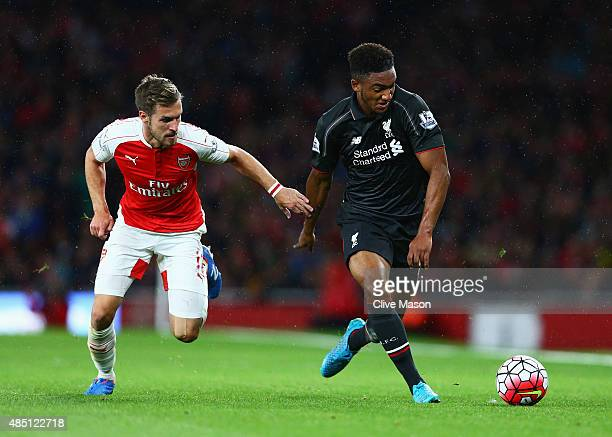 Joe Gomez of Liverpool is challenged by Aaron Ramsey of Arsenal during the Barclays Premier League match between Arsenal and Liverpool at Emirates...