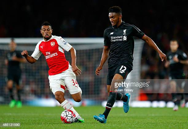 Joe Gomez of Liverpool is challenged by Francis Coquelin of Arsenal during the Barclays Premier League match between Arsenal and Liverpool at the...