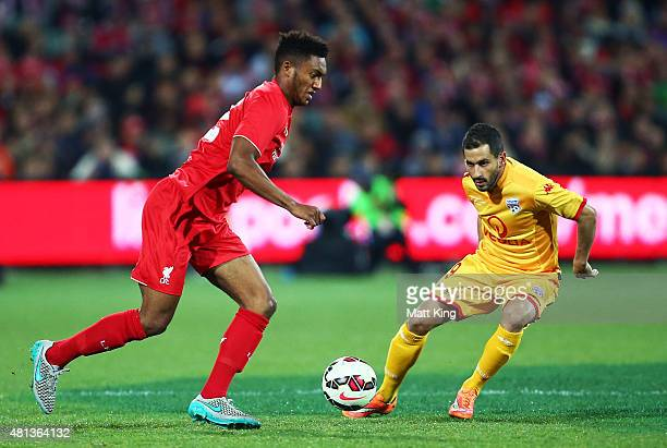 Joe Gomez of Liverpool is challenged by Sergio Cirio of United during the international friendly match between Adelaide United and Liverpool FC at...