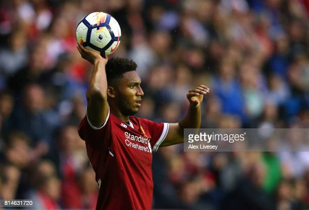 Joe Gomez of Liverpool takes a throw in during the preseason friendly match between Wigan Athletic and Liverpool at DW Stadium on July 14 2017 in...