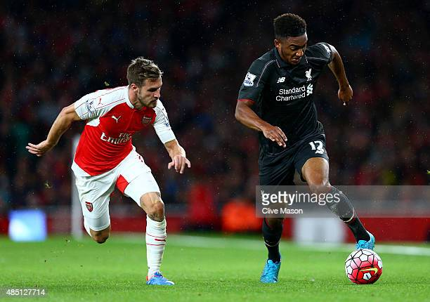 Joe Gomez of Liverpool takes on Aaron Ramsey of Arsenal during the Barclays Premier League match between Arsenal and Liverpool at the Emirates...