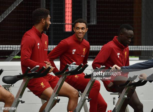 Joe Gomez Trent AlexanderArnold and Sadio Mane of Liverpool during a training session at Melwood Training Ground on September 7 2017 in Liverpool...
