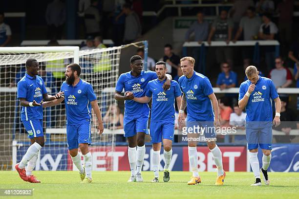Joe Gormley of Peterborough is congratulated by team mates after scoring to make it 10 during the pre season friendly match between Peterborough...