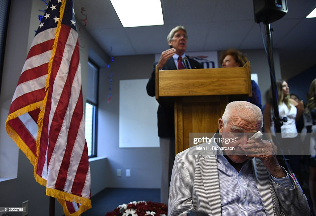 Joe Graham, the 98 year old father of Senate candidate hopeful Jack Graham, pumps his fist in support of his son, Jack Graham, behind him, as he gives his concession speech to members of his election team at their headquarters on June 29, 2016. Graham had hoped to win the primary to be able to take on Senator Michael Bennet but lost out to Darryl Glenn who won the Colorado Republican nomination for US Senate.