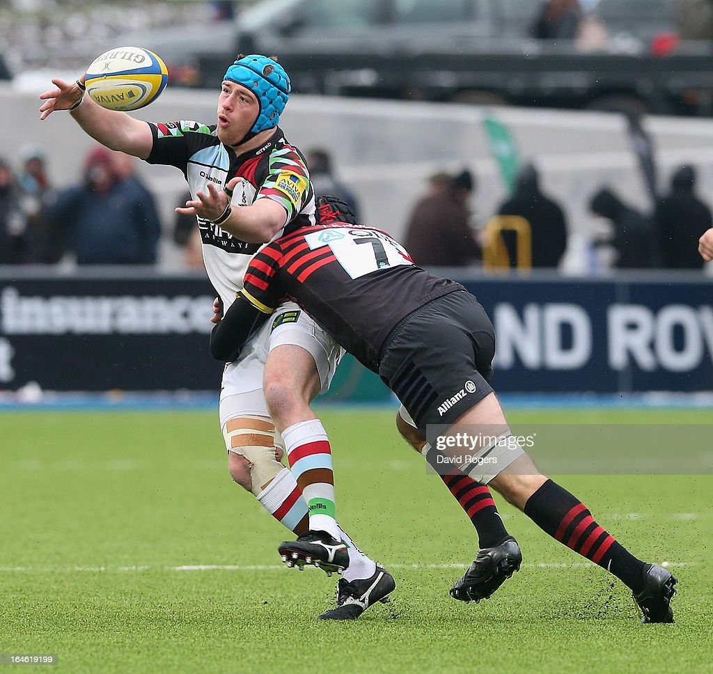 Joe Gray of Harlequins is tackled by Will Fraser during the Aviva Premiership match between Saracens and Harlequins at Allianz Park on March 24, 2013 in Barnet, England.