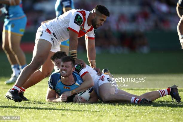Joe Greenwood of the Titans grimaces after a tackle during the round 23 NRL match between the St George Illawarra Dragons and the Gold Coast Titans...